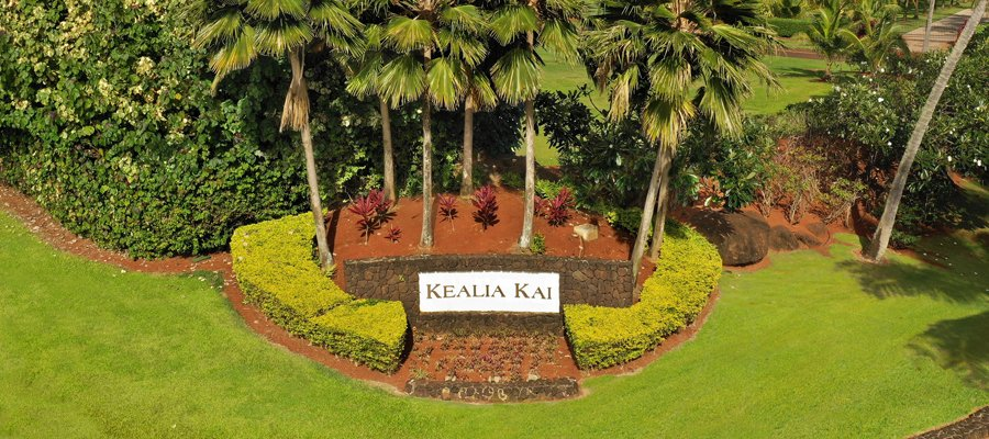 Rock wall sign 'Kealia Kai' upon entrance into Kealia Kai