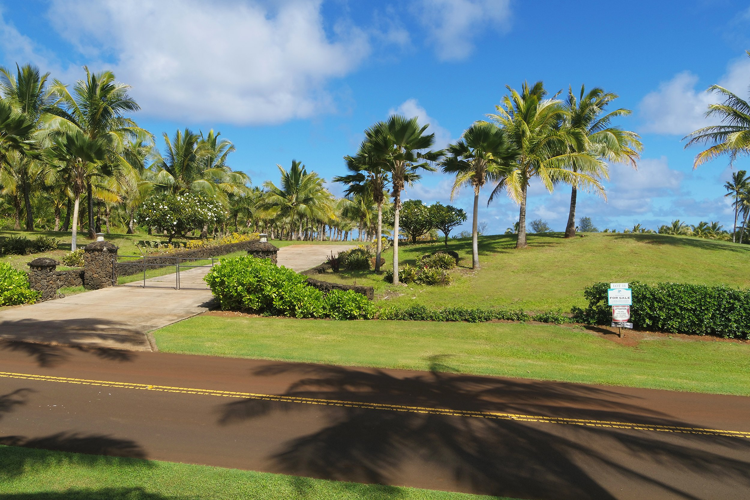 Street view shot of lot 18 of Kealia Kai on Kauai - Project Broker is Hannah Sirois