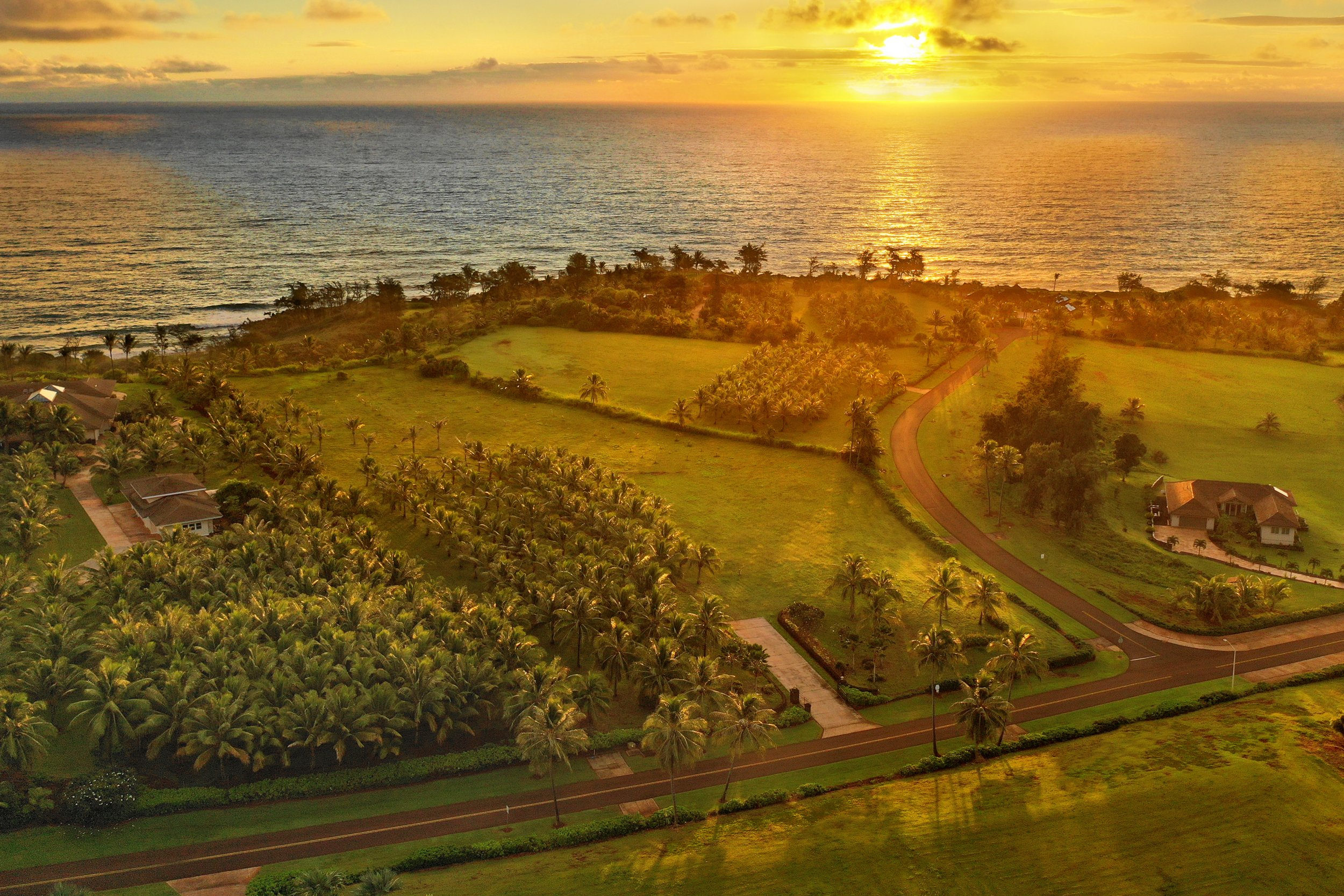 Aerial sunrise ocean view shot of lot 18 of Kealia Kai on Kauai - Project Broker is Hannah Sirois